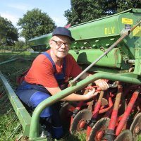Alfred Haase repairing the seed drill