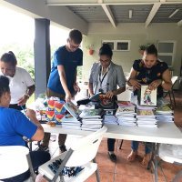 Employees of the Dominican Biotropic sort through the school supplies